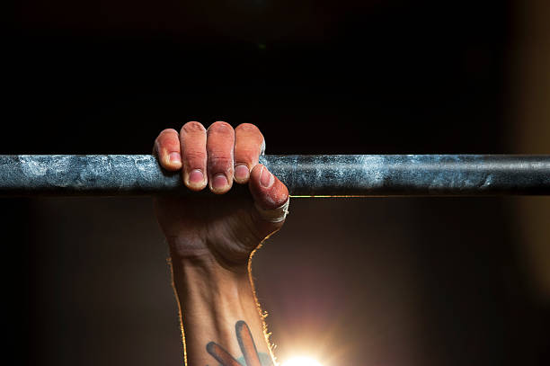 Closeup of male hand in horizontal bar. Pull up stock photo