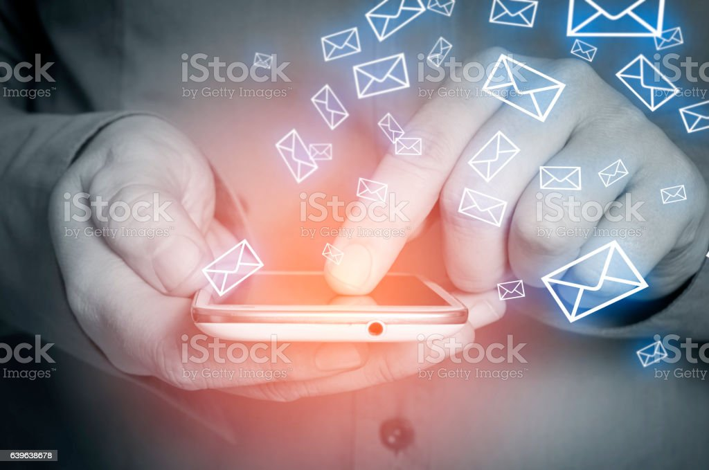 Closeup of male hand using smart phone for reading emails. stock photo