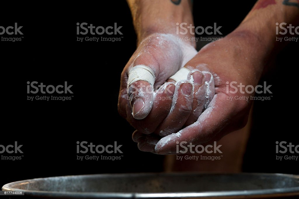 Closeup of male hands with talc powder stock photo
