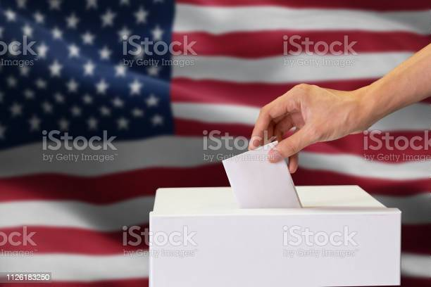Closeup of man casting and inserting a vote and choosing and making a picture id1126183250?b=1&k=6&m=1126183250&s=612x612&h=y6sz7z8a5a8v2bfvpyndxylkgdnh7giqnnabuelb49q=
