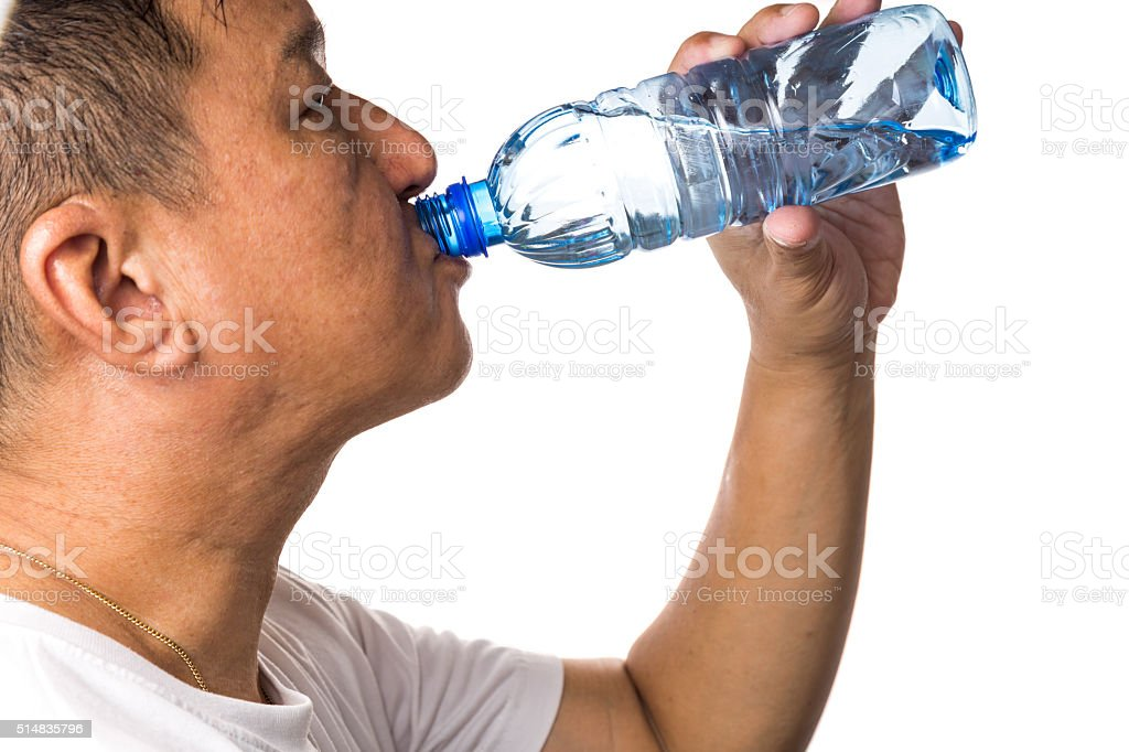 Closeup of man drinking refreshing cold water from bottle stock photo