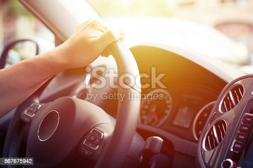 Close-up of Man Driving a Car Hand on Steering Wheel.