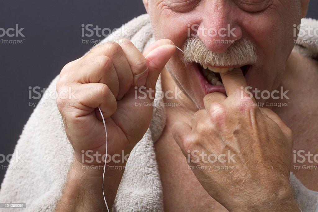 Close-Up of Man Flossing Teeth royalty-free stock photo