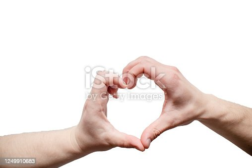istock Closeup of man hands making a heart love symbol 1249910683