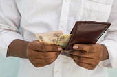 istock Closeup of Man hands taking Indian currency out of his wallet 1136299525