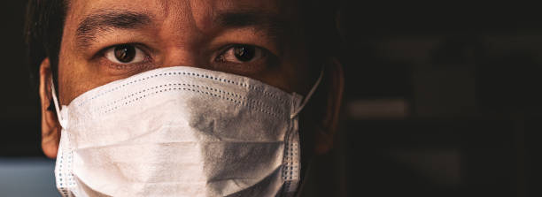 Closeup of man in mask Closeup of man in mask, concept of viral infection. Theme of corona-virus epidemic. covid mask stock pictures, royalty-free photos & images