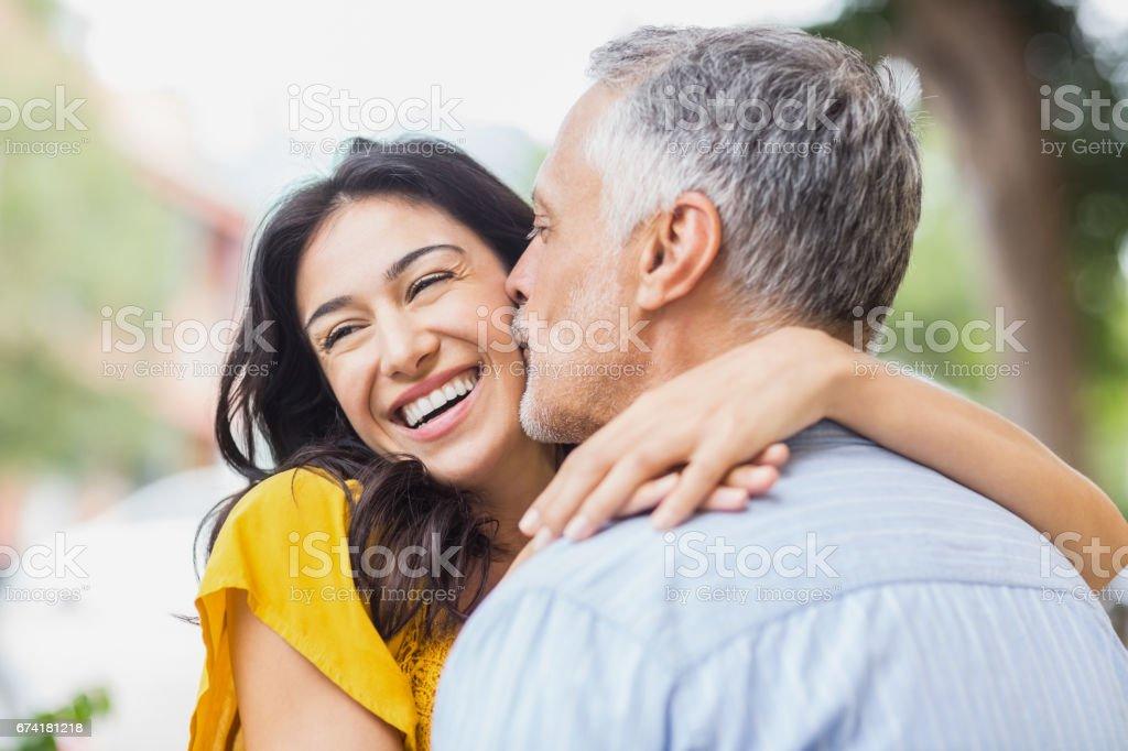 Close-up of man kissing woman stock photo