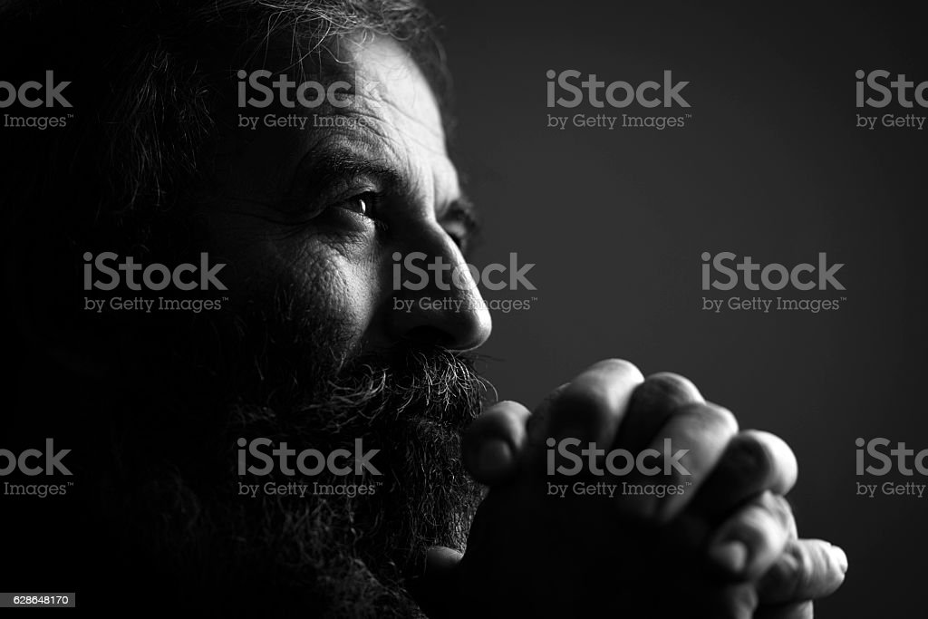 Close-Up Of Man Praying - Zbiór zdjęć royalty-free (50-59 lat)