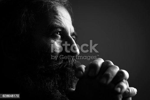 istock Close-Up Of Man Praying 628648170