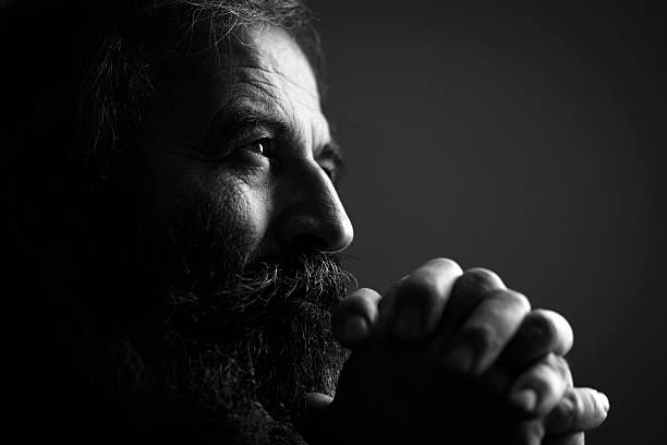 Close-Up Of Man Praying Close-Up Of Man Praying monochrome stock pictures, royalty-free photos & images