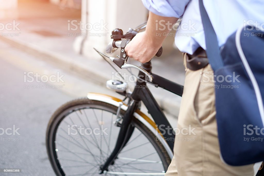 Close-up of man riding his bike in the street stock photo