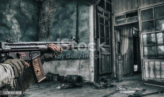Close-up of man shooting with machine gun.