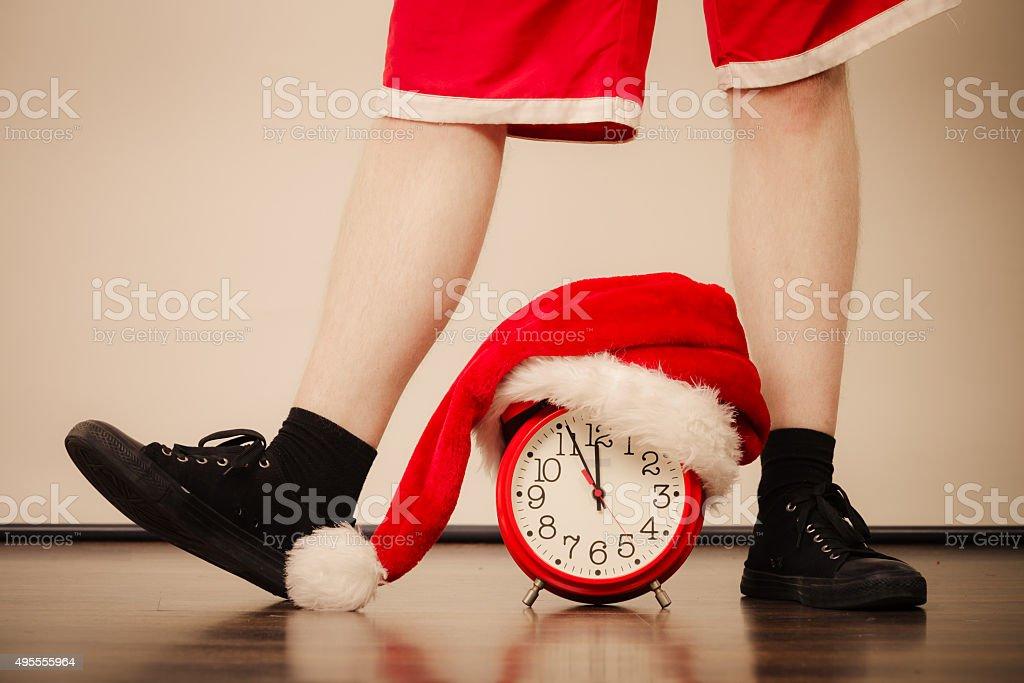 Closeup of man with alarm clock. Christmas time. stock photo