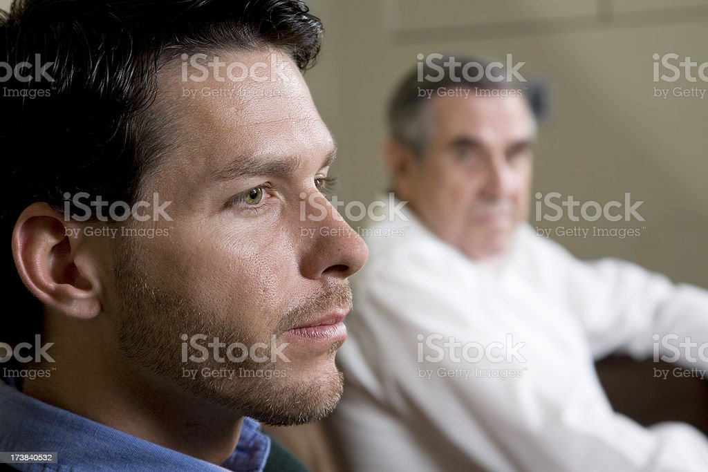 Closeup of man with father looking on stock photo