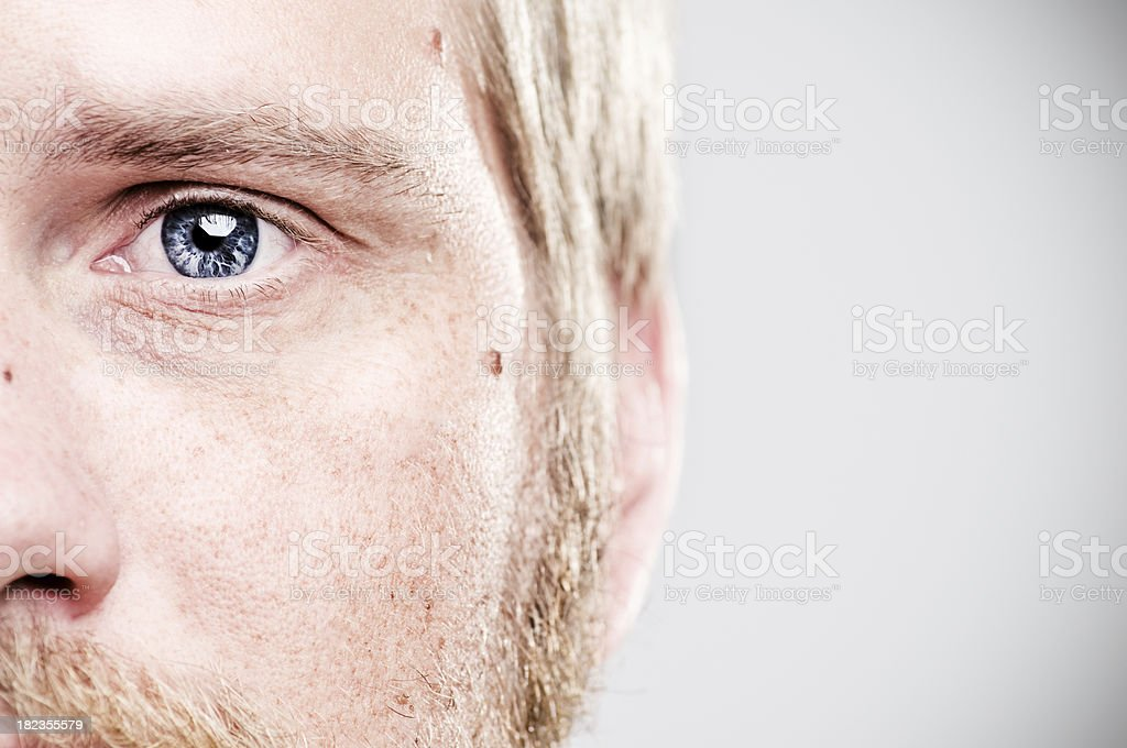 Close-up of mans blue left eye stock photo