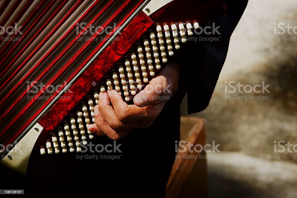 Close-up of Man's Hand Playing Vintage Accordion stock photo