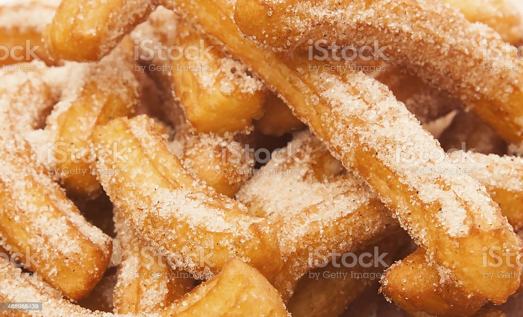 Close-up of many churros with sugar stock photo