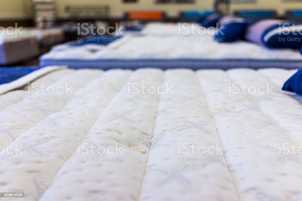 Closeup of many mattresses on display in store foto de stock royalty-free
