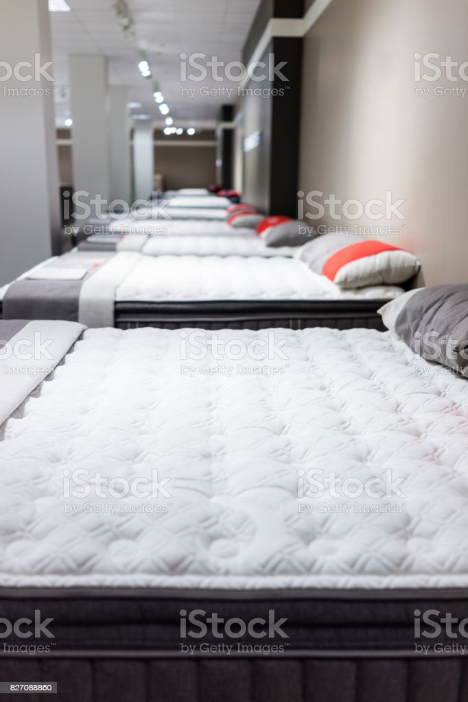 Closeup of many mattresses on display in store stock photo