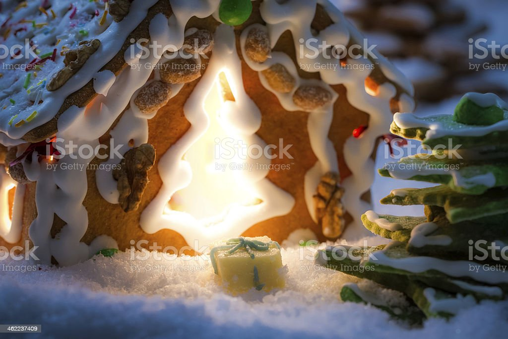 Closeup of marzipan gift near gingerbread cottage stock photo
