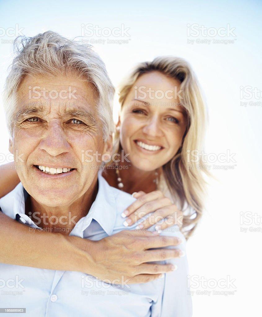 Closeup of mature man carrying a woman royalty-free stock photo