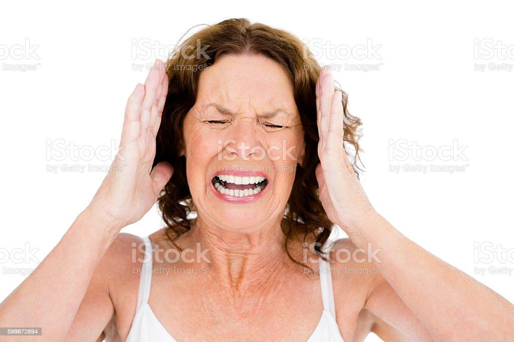 Close-up of mature woman shouting stock photo