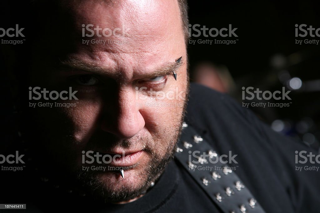 Closeup of Mean Looking Guitar Player royalty-free stock photo