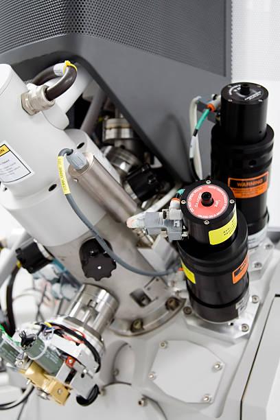 Closeup of mechanisms of E-Beam machine stock photo