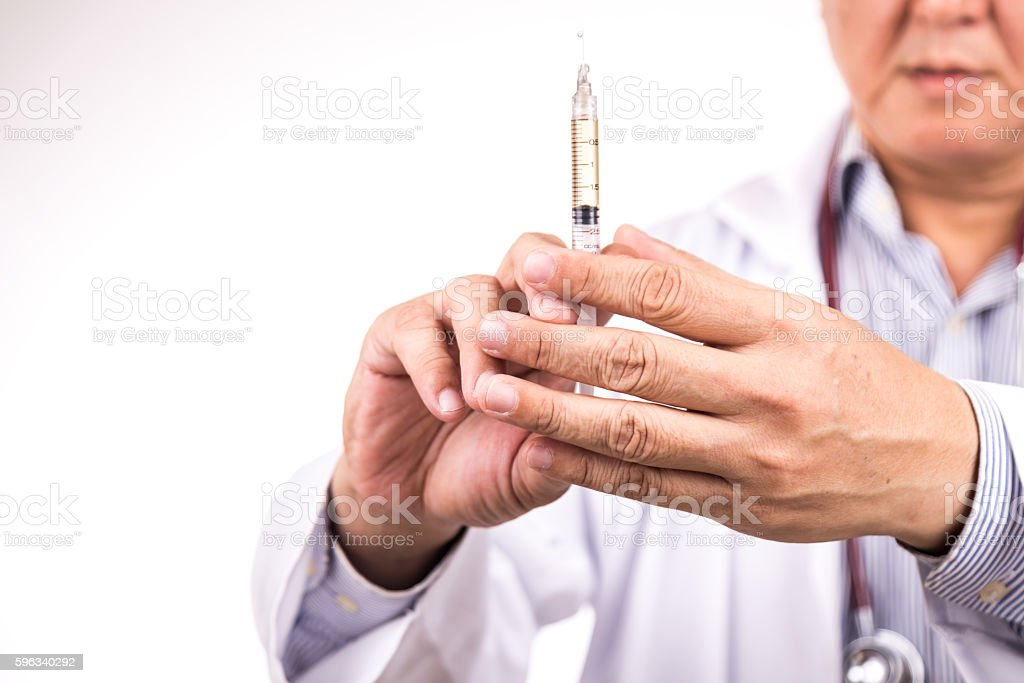 Closeup of medical doctor hand holding syringe for injection royalty-free stock photo