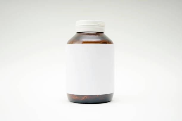 Primer plano de los frascos de medicamentos. - foto de stock