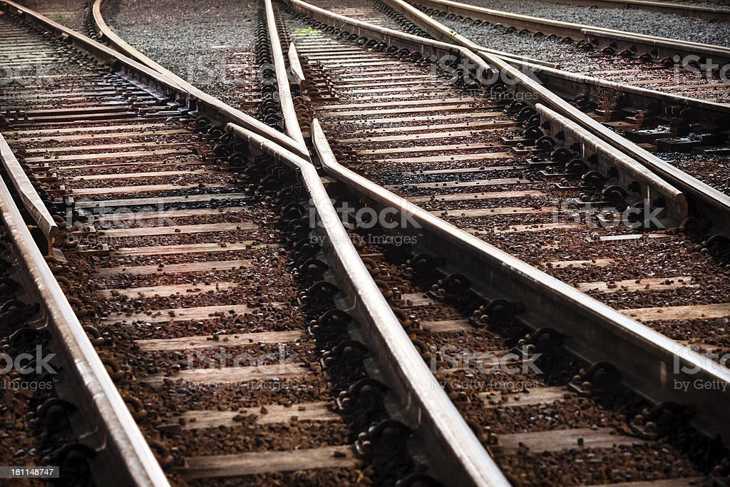 A close-up of merging railway tracks stock photo