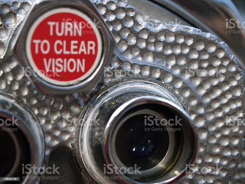 Close-up of metal binoculars with red sign on top stock photo