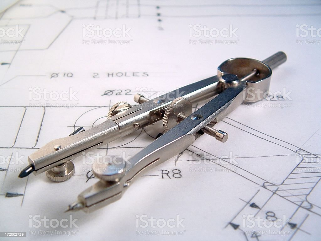 Close-up of metal compass on a blueprint stock photo