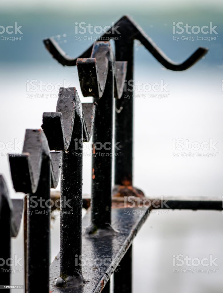 Closeup of metal fence with basic finials with out of focus background.. - Royalty-free Architecture Stock Photo