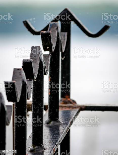 Closeup Of Metal Fence With Basic Finials With Out Of Focus Background Stock Photo - Download Image Now
