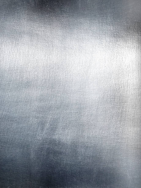 Close-up of metal plate with light refletion stock photo