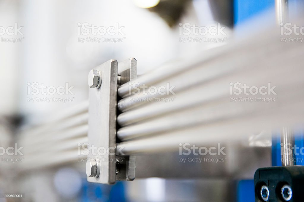 Close-up of metallic manufacturing equipment stock photo