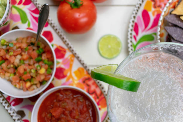 closeup of mexican food and margarita glass - cinco de mayo party stock photos and pictures