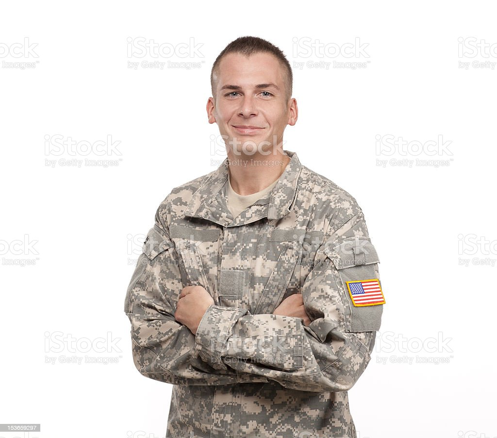 Close-up of military serviceman in uniform with arms crossed stock photo