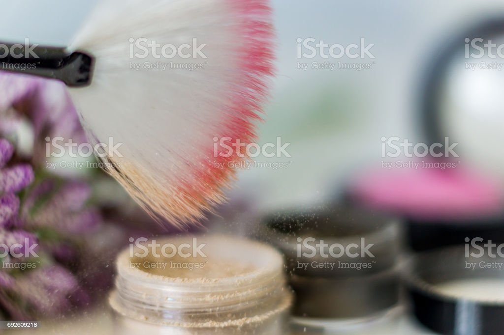 Close-up of mineral eyeshadow highlighter,  pressed shadows, and brush to apply the high-sheen. Suitable for sensitive skin, do not cause allergies, light and fine make-up composed of entirely natural products. Concept fashion beauty. stock photo