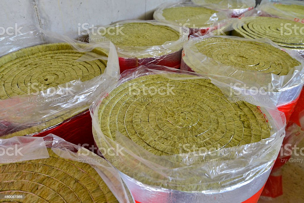 Close-up of mineral wool, fiberglass standing in raw rolled up stock photo
