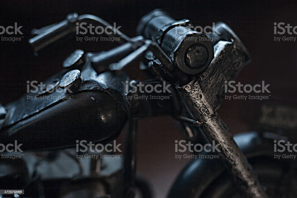 Close-up of miniature toy motorcycle on black background stock photo