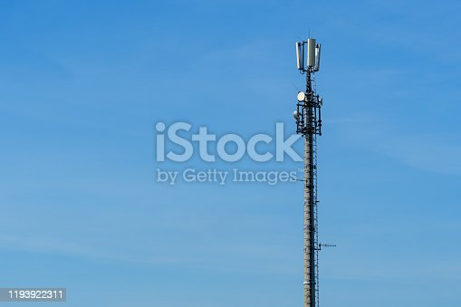 istock Closeup of mobile telecommunications tower or cell tower with antennae and electronic communications equipment - Copyspace 1193922311