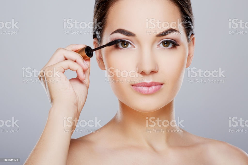 Closeup Of Model Painting Eyelashes With Mascara Stock Photo More