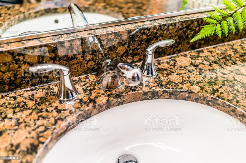 Closeup Of Modern Bathroom Sink With Brown Granite Countertop And Mirror Stock Photo Download Image Now Istock