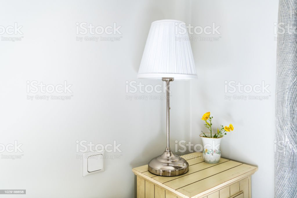 Closeup Of Modern Nightstand In Bedroom Room With Side Stainless