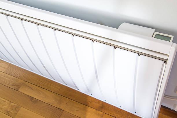closeup of modern radiator with digital temperature stock photo