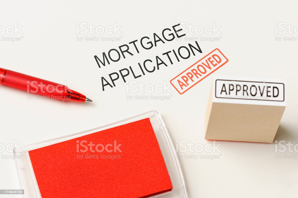 Close-up of mortgage application with 'Approved ' rubber stamp with hand royalty-free stock photo