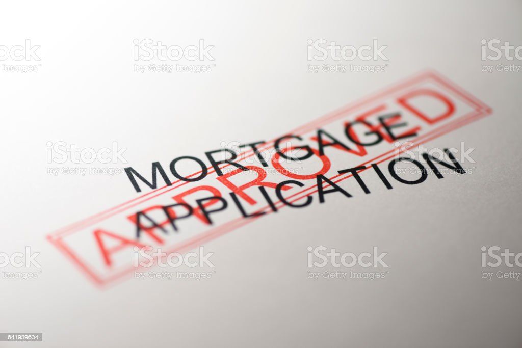 Close-up of mortgage application with approved stamped stock photo