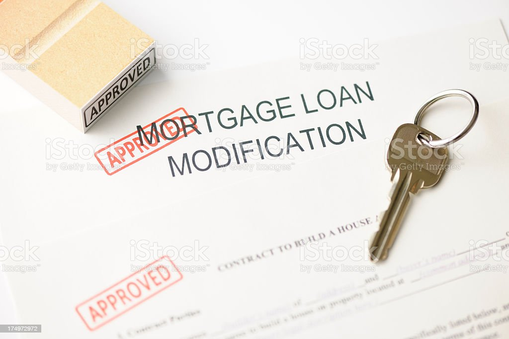 Close-up of mortgage modification with 'Approved ' rubber stamp with key royalty-free stock photo